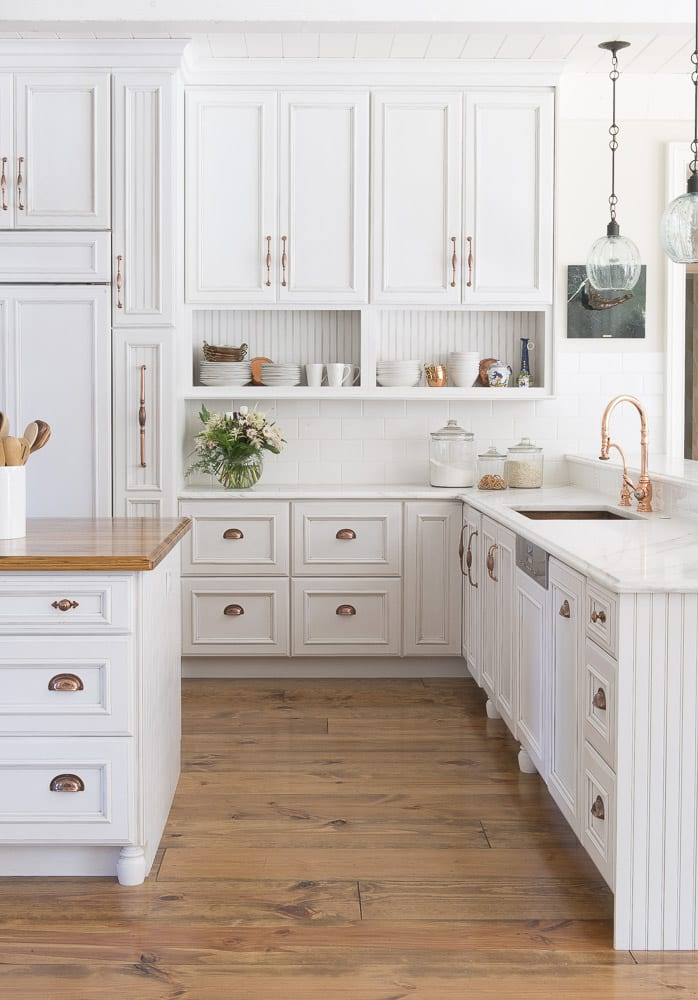 kitchen remodel white cabinets, marble tops, brass hardware
