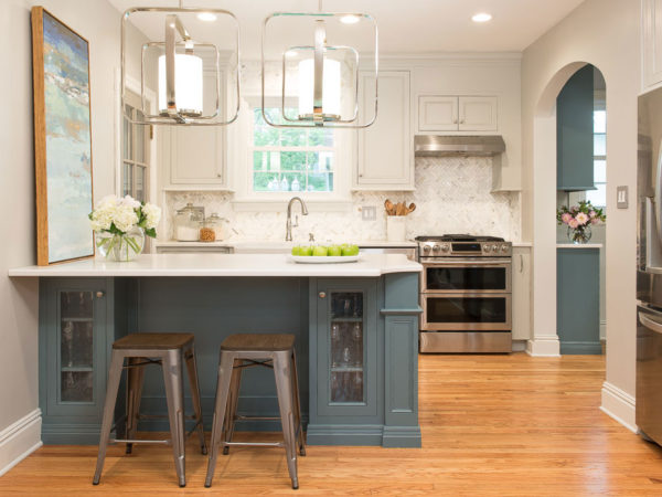 Blue island with wood floors and stainless appliances