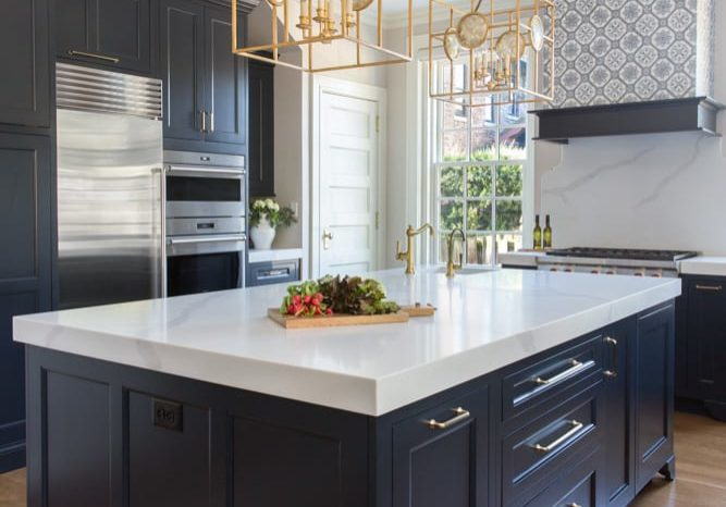 """To ensure enough space to come together, Owner Jenny added an island that is 2"""" taller than normal. The island needed to be multifunction as the kitchen is the place they cook, eat, do projects and wrap presents."""